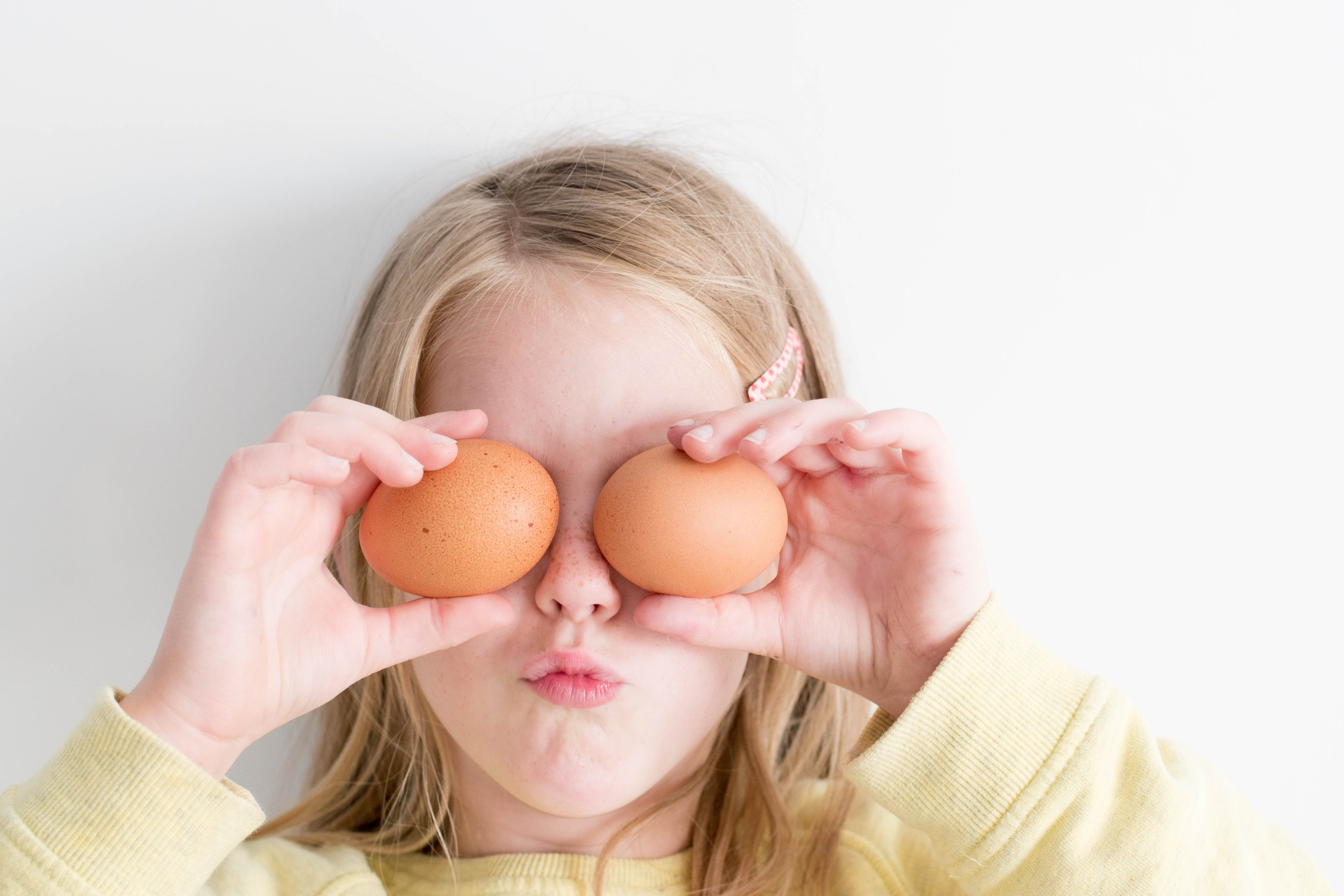child with eggs