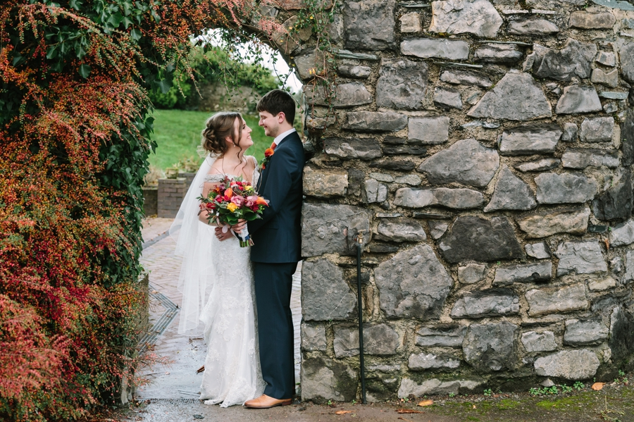 Seiont manor wedding with bride and groom in archway portrait