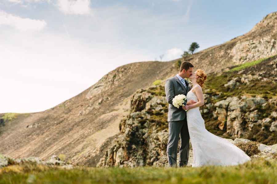 bride and groom kissing at sychnant pass. Get married in North Wales