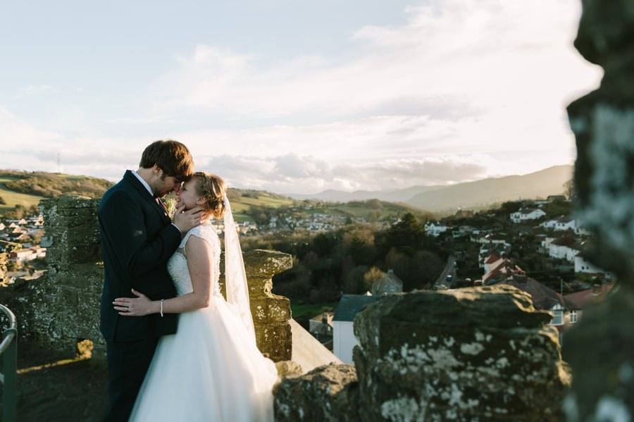 bride and groom on Conwy walls. Get married in North Wales