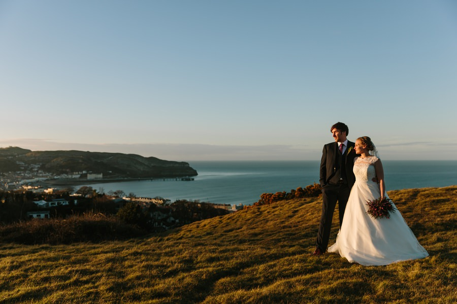bride and groom overlooking Llandudno Bay and great orme. Get married in North Wales
