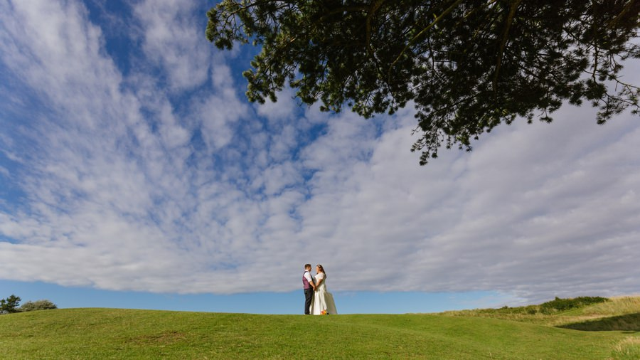 bride and groom on Abersoch golf course. Get married in North Wales
