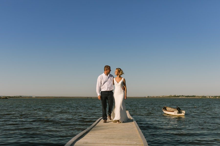 bride and groom on jetty in Treaddur bay. Get married in North Wales
