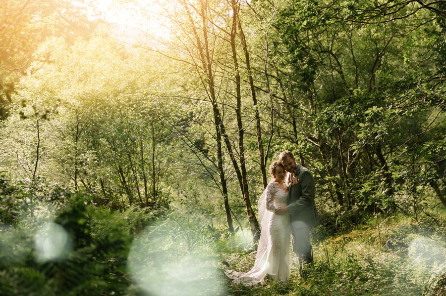 bride and groom in woods near Snowdon. Get married in North Wales