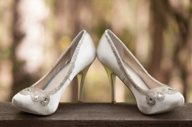 Brides wedding shoes with trees in background at Chaminade