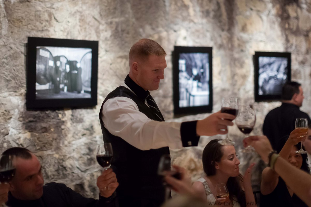 Groom toasting in the cave at the Testarosa Winery in Los Gatos.