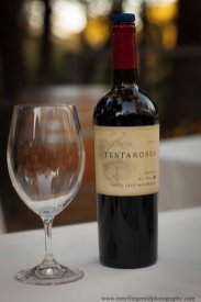 Testarossa wine bottle and glass.
