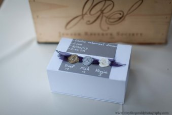 Wax seals for place settings at wedding rehearsal.
