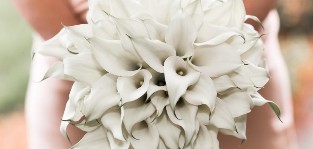 White bouquet held by bridesmaid in pink dress taken by Santa Cruz Wedding Photographer