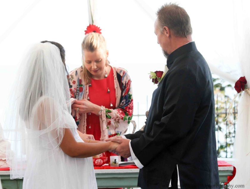 Woman pouring tea as officiant at wedding ceremony in Santa Cruz