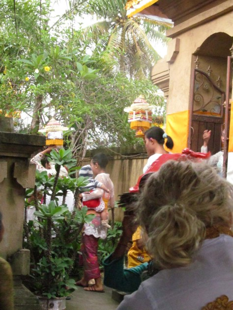 Offerings for the ceremony begin to arrive. Many women are practiced in carrying burdens on their head in Bali.