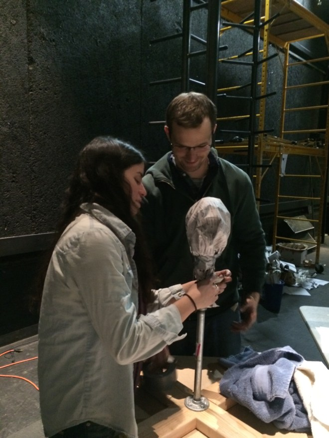 The actors made a ball of paper the size of their head and attached it to the armature stand. This helps them size the mask correctly.