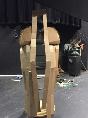 To help us all visualize, I constructed a hasty mockup in cardboard. It helped me strategize how I would eventually use the fabric-covered foam to create the cape.