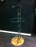 The scenery shop provided the first step , a steel ladder and on a wooden base, with two metal support ovals.