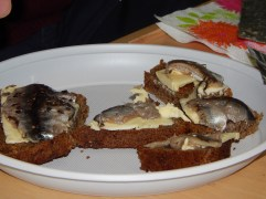 Sprats on rye bread, with butter