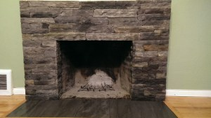 Fireplace With Stone Veneer Facing And Ceramic Tile Hearth