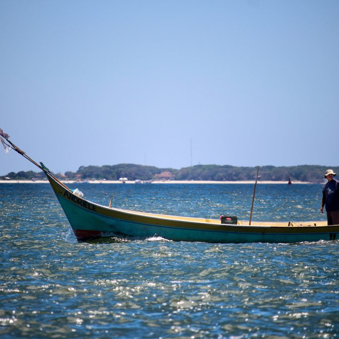 End of the fishing day in Pontal do Paraná, Brazil by Mirella Leis, 2014