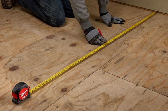 Milwaukee Tape Measure Extended and Flat on Floor