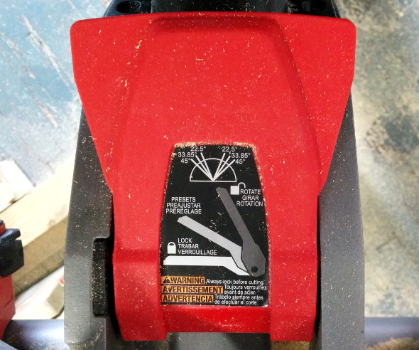 M18 Fuel Miter Saw closeup of the bevel adjustment paddle