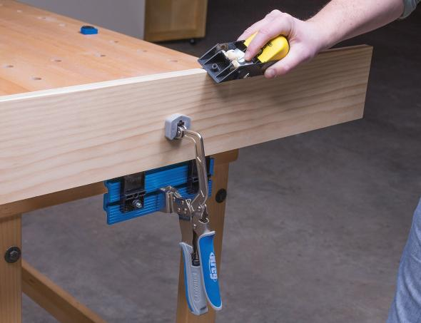 Kreg Bench Vise holding a board for planing