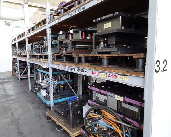 shelves full of dies for aluminum die-casting and plastic injection molding at Metabo factory