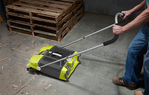 Ryobi Devour Cordless Sweeper Cleaning a Mess