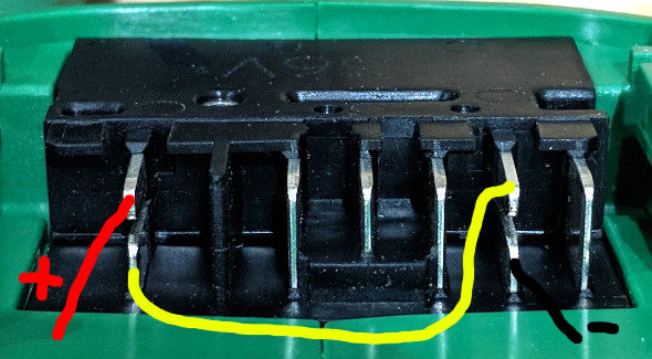 Closeup of Hitachi MV tool battery connector possible wiring