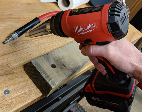 Milwaukee Cordless Heat Gun warming a rubber strain relief