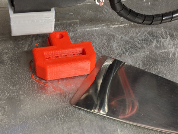 Using a print removal tool to remove a 3D print