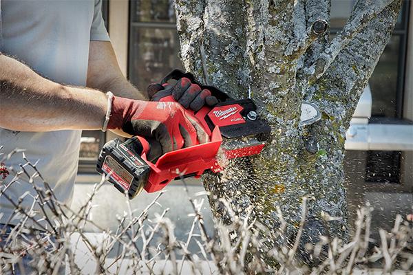 Milwaukee M12 Hatchet Chainsaw Cutting Large Branch