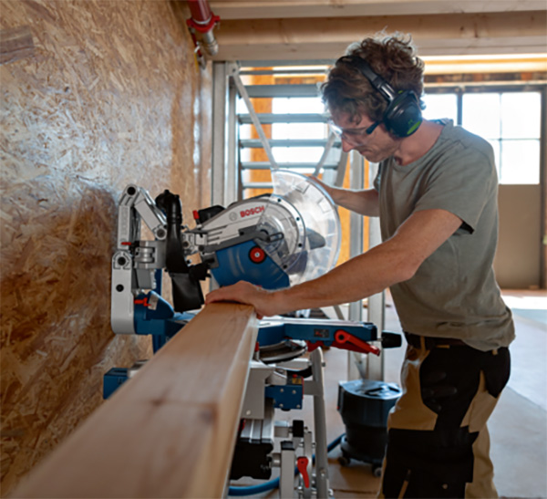 Bosch GCM 18V-305 GDC BITURBO Cordless Miter Saw Against Wall
