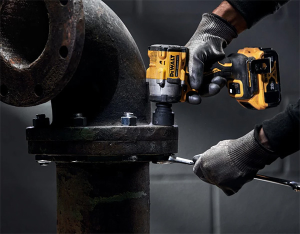 Dewalt DCF921B Atomic Impact Wrench Used on Large Pipe Fitting