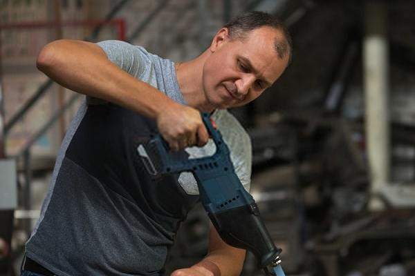 Man Using the Best Reciprocating Saws