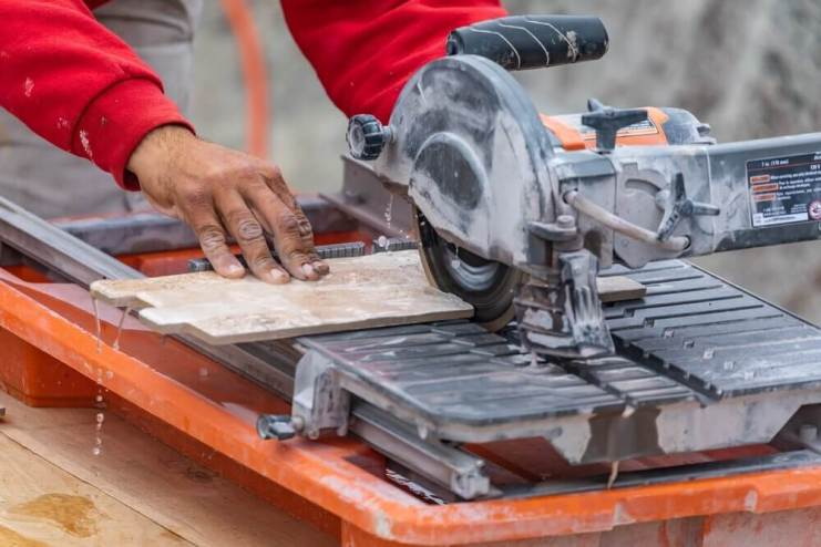 Worker Using Wet Tile Saw