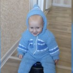Toddler rides robot vacuum cleaner