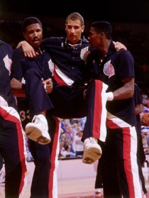Sam Bowie carried off court