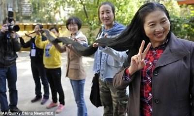 Ni Linmei entre os cabelos mais longos do mundo