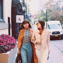 70s inspired neutral coats and high waist pants