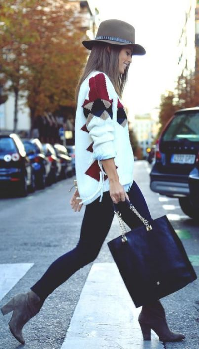 loose sweater and black leather bag
