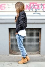 bomber jacket, ripped boyfriend jeans, tan leather boots