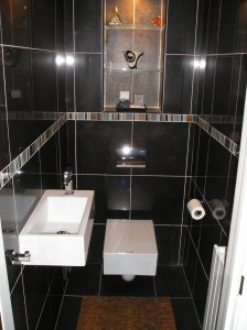 Contemporary cloakroom with square WC & basin. Black tiles enhance it greatly.
