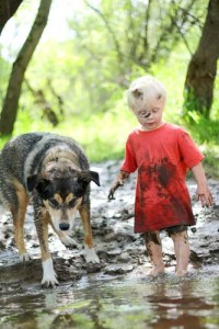 kid and dog in mud