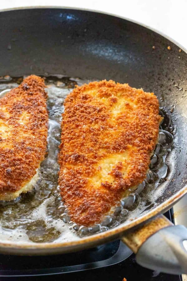 chicken frying in a nonstick pan with golden surface