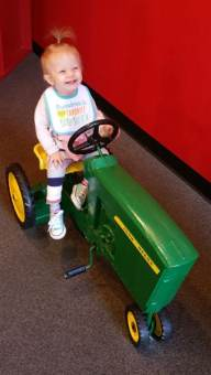 Lucy on a tractor