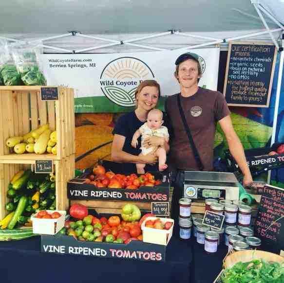 Wild Coyote Farms' Co-founders with their baby in their Chicago Farmers' Market station