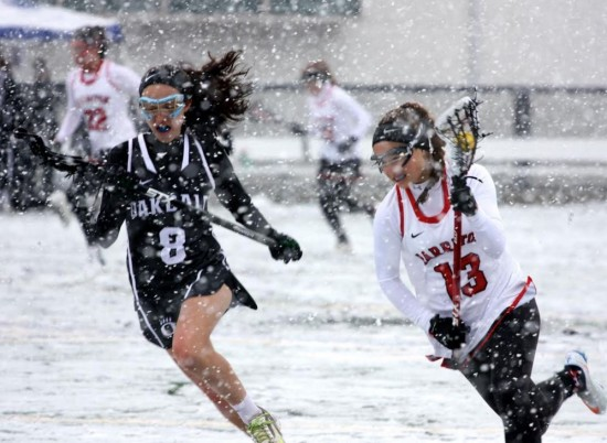 Harriton's Laura Lasprogata (right) heads downfioeld in the snow at Agnes Irwin in the rams' 15-10 win over oakdale at Checking for cancer. Snow cancelled half the games