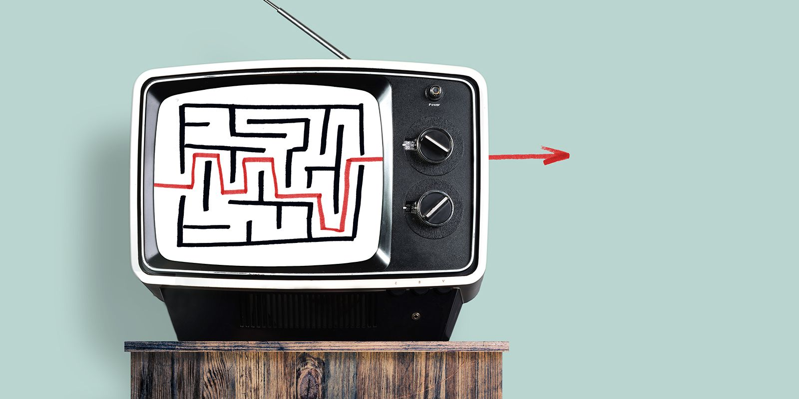 Old tv showing a labyrinth on white screen. A red arrow is getting out of the labyrinth past the tv on the video SEO services page.