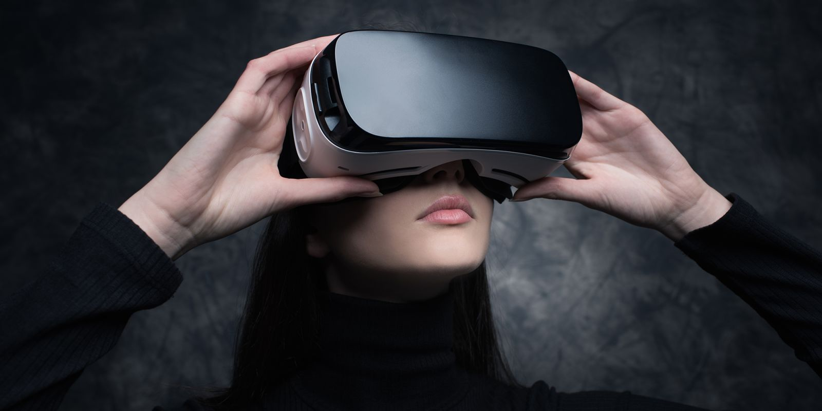 An image of a woman with virtual reality glasses on on the virtual reality agency page.