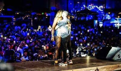Wizkid and Tiwa Savage share a kiss on stage in Paris