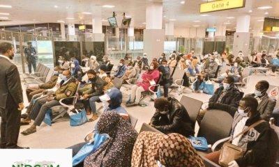 118 Nigerians stranded in Libya arrive in Abuja, says NIDCOM